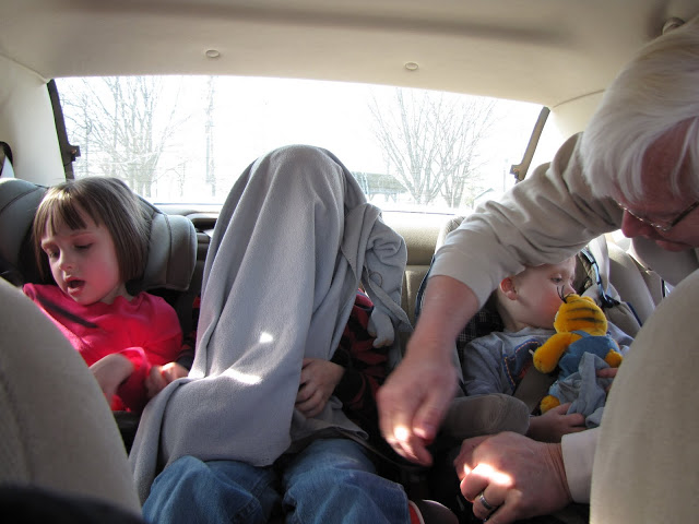 Getting the kids buckled as we got ready to drive from MN to TN